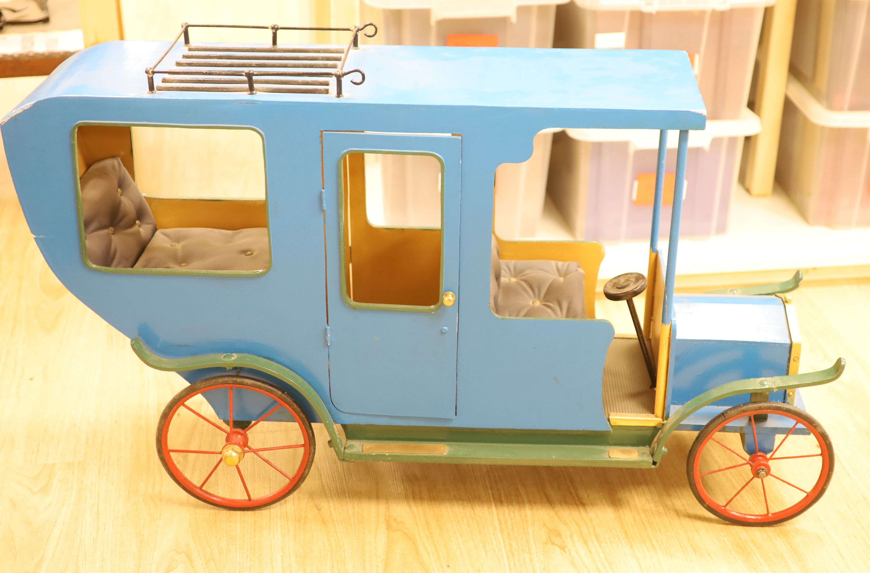 A novelty early 20th century model car, width 108cm height 62cm