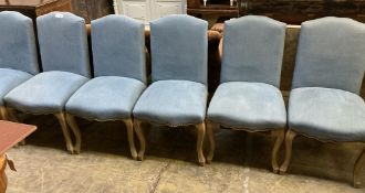 A set of six blue linen covered dining chairs, width 50cm depth 50cm height 94cm