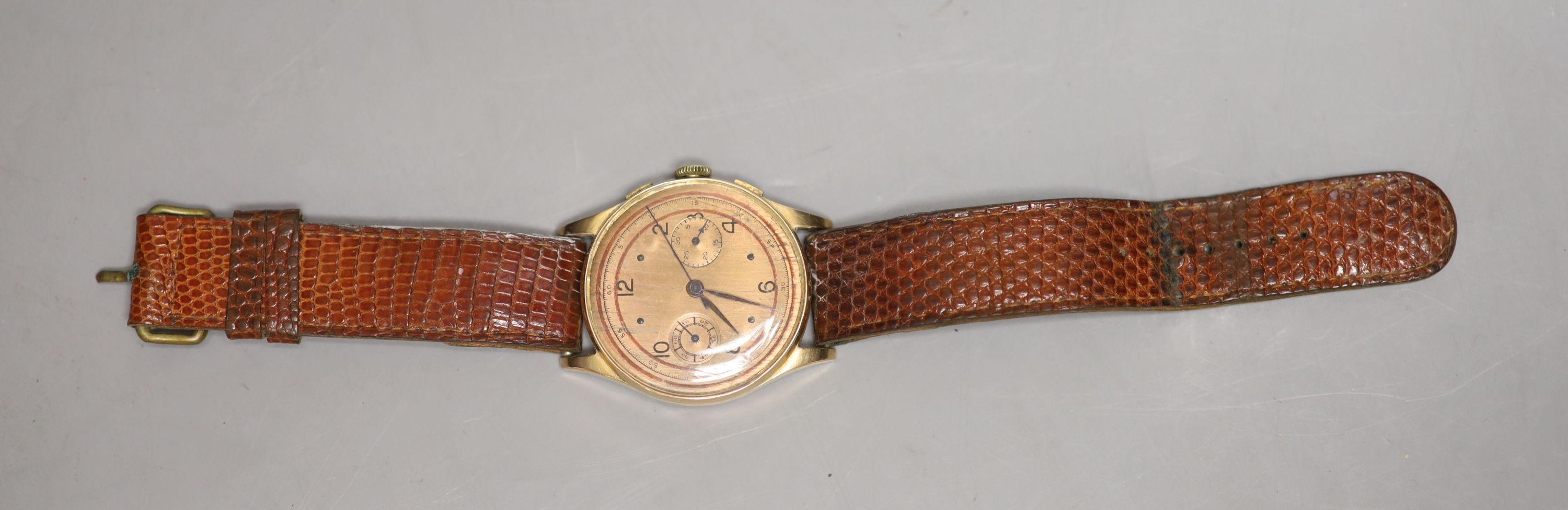 A Swiss 18k yellow metal chronograph manual wind wrist watch, on associated leather strap, with a - Image 2 of 3
