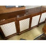 A Regency style mahogany breakfront cabinet, width 240cm, depth 64cm, height 91cm