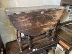 A small 18th century oak oval-topped gateleg table, width 83cm, length 96cm extended, height 62cm