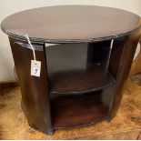 An oval mahogany three tier occasional table, width 64cm depth 50cm height 55cm