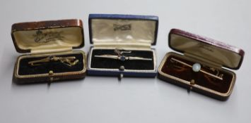 Three assorted Edwardian and later yellow metal bar brooches including a sapphire and seed pearl,