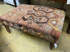 A rectangular Kelim covered stool, width 94cm depth 70cm height 38cm