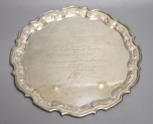 An Anglo-Indian Sterling silver presentation salver, having piecrust edge and conforming embossed
