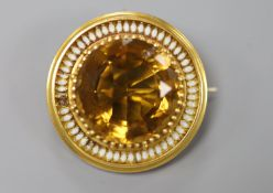 A Victorian yellow metal, citrine(chipped) and white enamel set target pendant brooch, 37mm, gross