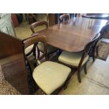 A George III style mahogany twin pillar extending dining table, extended 270cm (one spare leaf),