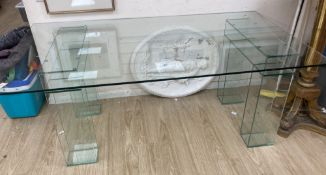 A contemporary rectangular glass dining table, width 180cm, depth 100cm, height 74cm