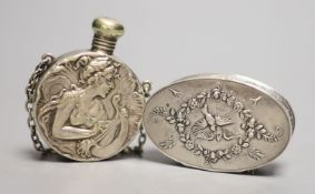 An early 20th century French white metal oval compact, 57mm and a silver plated scent flask.