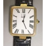 A gentleman's silver gilt Dunhill quartz shaped rectangular dial wrist watch, on a leather strap