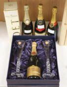 Four bottles of NV Champagne, Perrier Jouet, Bollinger and Louis Roederer, Moet & Chandon and a