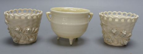 A Belleek cauldron and a pair of Belleek pots, tallest 6cmCONDITION: Cauldron has rough dark