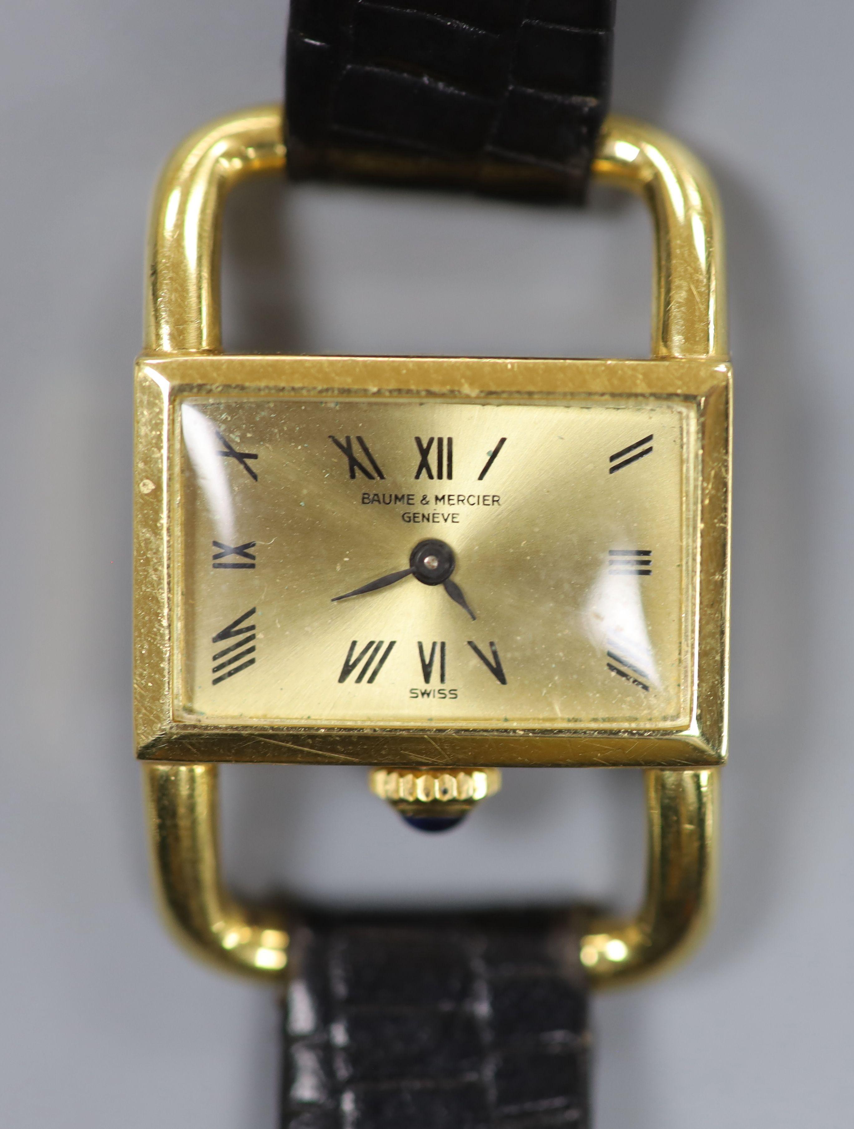 A lady's modern 750 yellow metal Baume & Mercier manual wind rectangular dress wrist watch, on a