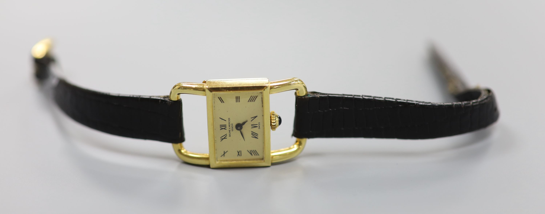 A lady's modern 750 yellow metal Baume & Mercier manual wind rectangular dress wrist watch, on a - Image 2 of 3
