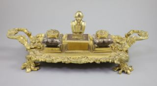 A Victorian ormolu ink stand, the central wafer box applied with a bust of a Shakespeare and flanked
