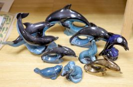 Six Poole pottery dolphins together with two similar seals and an otter