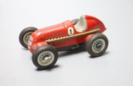 A Schuco Studio 1050 clockwork Mercedes racing car in red, length 14cm steering wheel and key
