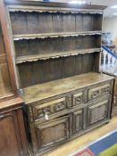 An early 20th century Jacobean style oak dresser, width 150cm, depth 47cm, height 199cm