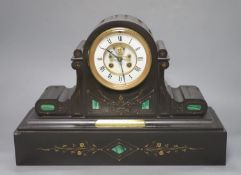 A Victorian black marble and inlaid malachite eight day mantel clock, plaque reads 'Presented to