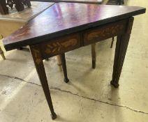 An early 19th century Dutch marquetry inlaid walnut triangular folding tea table, width 93cm,