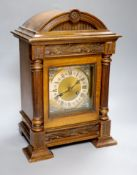 A German walnut mantel clock, converted to electric regulation, height 44cm