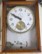 A Brillie walnut, marble and brass electric wall clock, 46cm