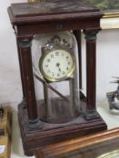 An early 20th century mahogany and brass electric mantel clock, with integral glass dome,