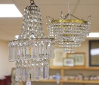 A glass lustre chandelier and another