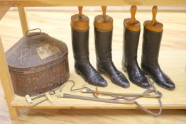 Two pairs of riding boots and trees together with two boot pulls and riding crops and a toleware hat