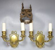 A pair of bronze two branch wall sconces, together with a South East Asian 'dragon' door knocker