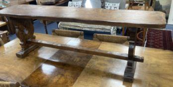 A 17th century style oak bench, length 138cm, depth 29cm, height 44cm