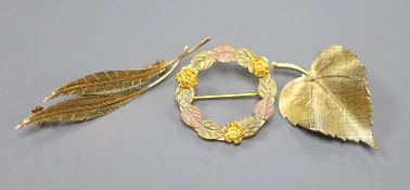 A 585 yellow metal double leaf brooch, 51mm, 2.5 grams, a 9ct gold leaf brooch, 3 grams and a 10k