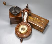 An aneroid barometer together with a 19th century mahogany coffee grinder and an inlaid box