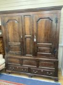 A mid 18th century oak panelled two part hanging cupboard, width 156cm, depth 53cm, height 188cm