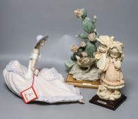 Two G Armani porcelain sculptures and a Nao figure of a lady