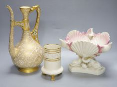 A Royal Worcester ewer, in the Persian style, a 'shell and dolphin' centrepiece and a vase,