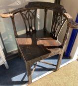 A George III carved mahogany corner elbow chair, width 76cm, depth 64cm, height 82cm