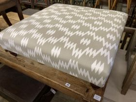 A contemporary Victorian style footstool upholstered in grey / ivory fabric, length 85cm, depth