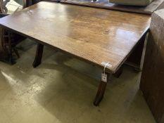 An early 20th century rectangular oak X frame refectory dining table, length 167cm, depth 80cm,