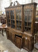 A George III style mahogany and walnut banded breakfront bookcase, with pierced broken swan neck