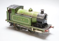 An early 20th century tinplate live steam loco converted to electricity, length 28cm