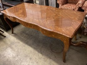 A Louis XVI design marquetry inlaid kingwood serpentine centre table W.196cm. D 90cm. H 79cm.