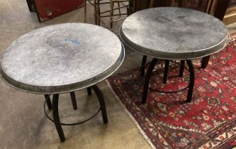 Two industrial style circular metal occasional tables, 54cm diameter, height 44cm