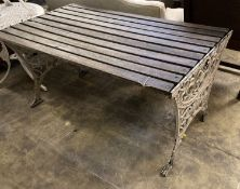 A Victorian style slatted rectangular cast metal base garden table, length 124cm, depth 68cm, height
