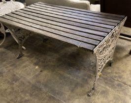 A Victorian style slatted rectangular cast metal base garden table, length 124cm, depth 68cm, height