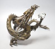 A large Japanese bronze model of a dragon clasping a glass 'jewel', 29.5cm across