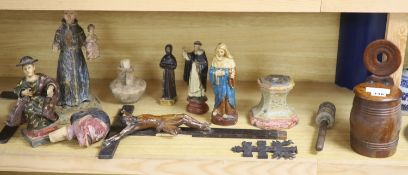 A collection of Spanish/South American carved wood or composition figures of Saints, salt box etc,