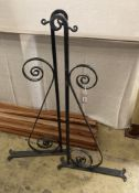 A pair of black painted wrought iron wall mounting brackets, width 114cm, height 54cm