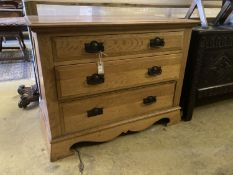A late Victorian oak chest of three drawers, width 106cm, depth 55cm, height 81cm
