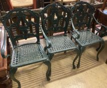 A set of four painted cast aluminium garden chairs (two with arms)